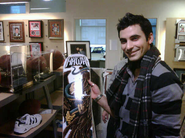 Jason with an autographed skate board from Shaun White at the offices of Grand Stand Sports in New York