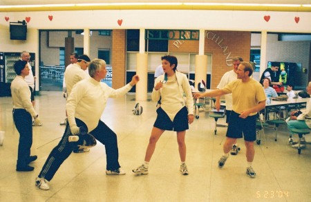 Buckie Leach (on the far right) leading a fencing clinic
